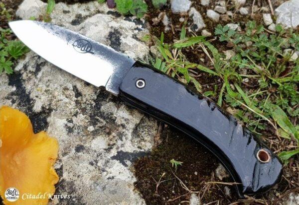 Couteau pliant friction